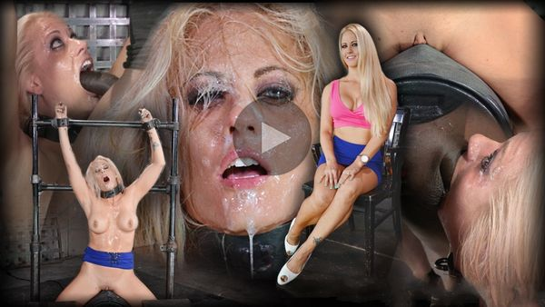 (12.08.2014) SB – Big breasted bimbo MILF Holly Heart shackled to a sybian and throat trained by 2 cocks, cums hard